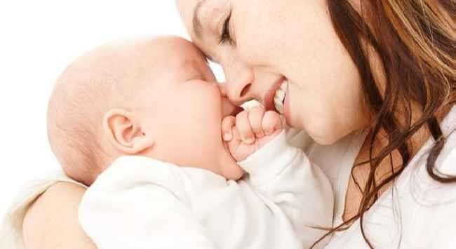 К чему снится женщина кормящая младенца фото