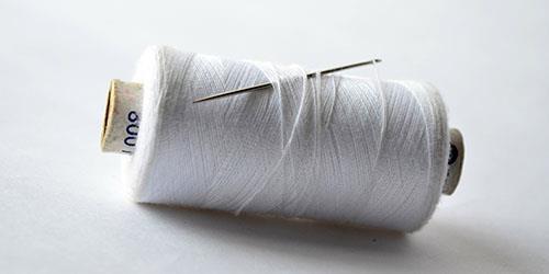 шить белой ниткой во сне