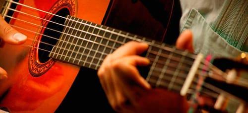 к чему снится играть на гитаре