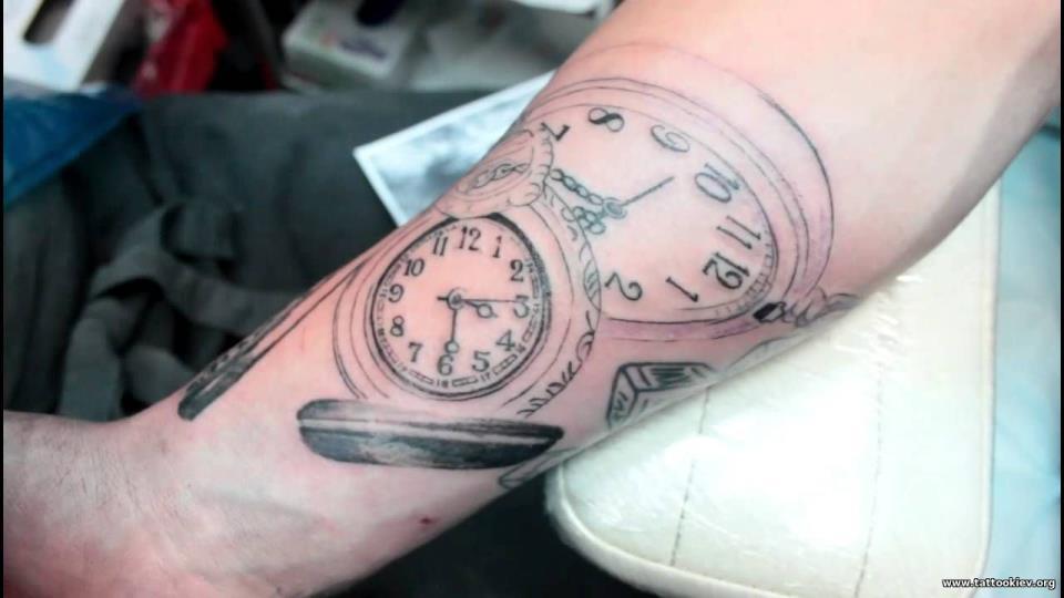 Значение татуировки часы